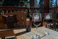 Two glasses of red wine sit on a patio table at John Muir Lodge in Kings Canyon National Park